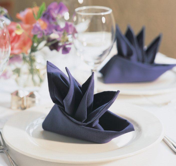 Purple napkins on hotel table